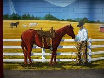 Cowboy Horses Ranch, Wall Mural. Cowboy and horses on ranch. Brick wall mural Royalty Free Stock Images