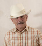 Cowboy i den vita hatten Arkivfoto