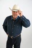 Cowboy inclinant le chapeau Image libre de droits