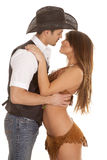 Cowboy and indian woman embrace almost kiss Royalty Free Stock Photos