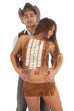 Cowboy and Indian woman her in front hands belly Stock Photos