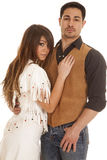 Cowboy and Indian woman her hand on his vest Royalty Free Stock Images