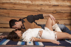 Cowboy and indian woman lay him top almost kiss Royalty Free Stock Photo