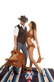 Cowboy and Indian woman saddle and club Stock Image