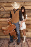 Cowboy and Indian woman saddle looking down Stock Image