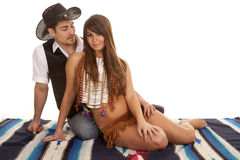 Cowboy and Indian woman sit him look at her Stock Photos