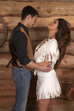 Cowboy and Indian woman white skirt head back Stock Photography