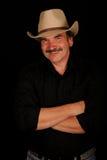Cowboy invecchiato centrale sorridente Immagine Stock Libera da Diritti