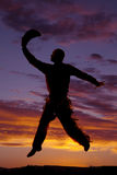Cowboy jump in sunset Stock Photography