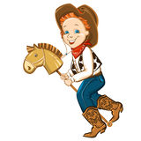 Cowboy kid and toy horse Royalty Free Stock Photo