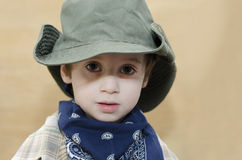 Cowboy kid. Young boy with cowboy hat Stock Photos