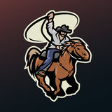 Cowboy with a lasso on a horse. Royalty Free Stock Photography