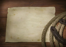 Cowboy lasso and horseshoe Stock Photos