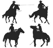 Cowboy with lasso riding a horse Stock Image