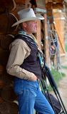 Cowboy Leaning Against Building - Side Royalty Free Stock Image