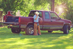 Cowboy. A cowboy leaning against his truck Royalty Free Stock Photos