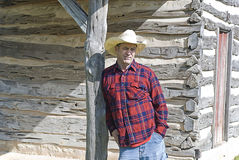 Cowboy Leaning on a Wooden Post Stock Image