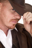 Cowboy leather coat hat close looking Stock Images
