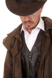 Cowboy leather coat hat looking down Royalty Free Stock Photography