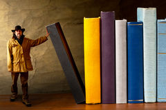 A cowboy in the library Royalty Free Stock Image