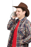 Cowboy listening funny radio Royalty Free Stock Photo