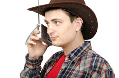 Cowboy listening weather forecast on the radio Stock Image
