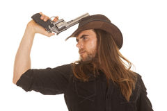 Cowboy long hair hold pistol by hat Royalty Free Stock Photos