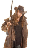 Cowboy long hair rifle over shoulder look Stock Photography