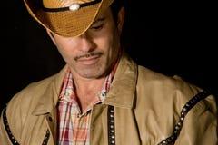 Cowboy lookig neer Royalty-vrije Stock Foto's