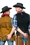 Cowboy love. Two men in cowboy costumes holding hands on each other. Clipping path included Royalty Free Stock Photos