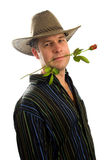 Cowboy in love with rose in mouth Royalty Free Stock Image