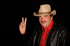 Cowboy making victory sign Royalty Free Stock Images