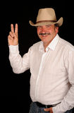 Cowboy making victory sign Stock Images