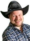 Cowboy man at plaid shirt with black hat Stock Photography