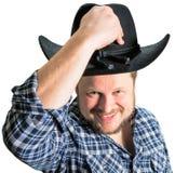 Cowboy man at plaid shirt with black hat Stock Image