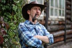 Cowboy man smoke pipe Stock Images