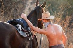 Cowboy med en horse3 Arkivfoto
