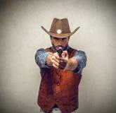 Cowboy med ett vapen Royaltyfri Bild