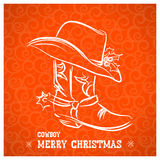 Cowboy merry christmas with cowboy boot and western hat Royalty Free Stock Photography