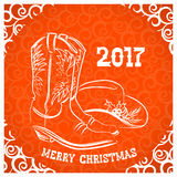 Cowboy merry christmas with cowboy boots and western hat decorat Royalty Free Stock Photo