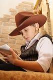Cowboy met tablet Royalty-vrije Stock Afbeeldingen