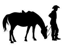 Cowboy met zijn Paard Stock Afbeelding