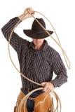 Cowboy mit dem Seil obenliegend stockfoto