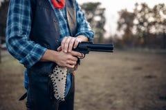 Cowboy mit Revolver macht den Schnellschuss, West stockfoto