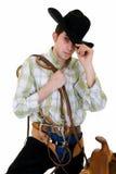 Cowboy mit Sattel und Zügel Stockfoto