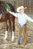 Cowboy mit seinem Pferd Stockbilder