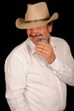 Cowboy with mobile telephone Royalty Free Stock Images