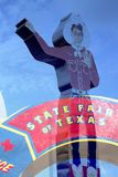 Cowboy model and  State Fair of Texas sign Royalty Free Stock Images