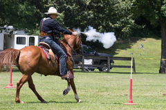 Cowboy Mounted shooting Royalty Free Stock Photography