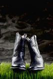 Cowboy Nights. Black cowboy boots at the cowboy night time with room for your type royalty free stock photos